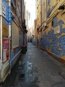 "Picture of the Between Two Worlds art installation in Sydney. Blue painted ""auspicious clouds"" stretch down an alley."